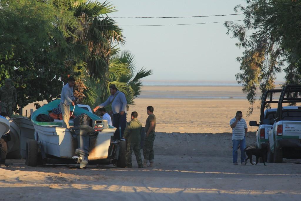 Mexican government officials question local fisherman in El Golfo de Santa Clara. Photo by Sean Bogle.