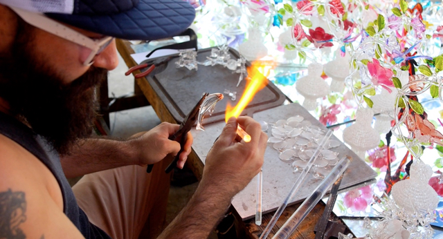 Artisan glass artist creating a vaquita sculpture.